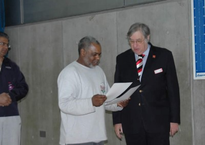 Henry T. Gaspard receives Clubmark Award from Eric Brown